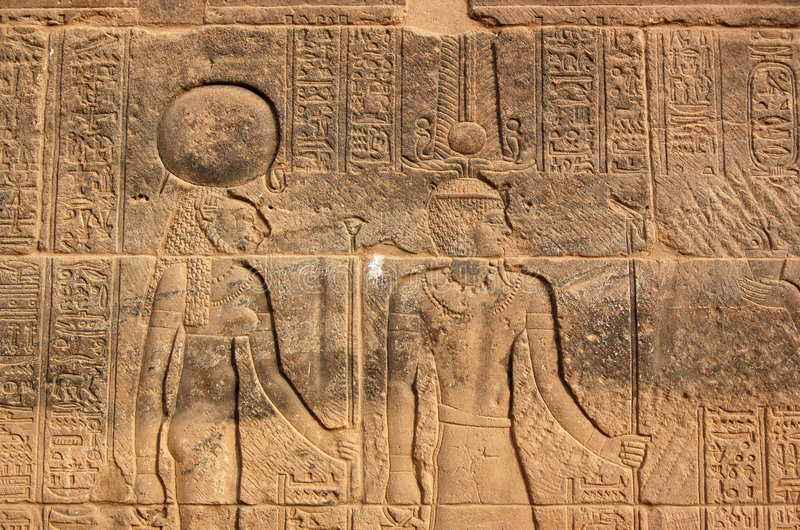 Sekhmet and Amun Ra. Carving on the wall of the Temple of Isis at Philae, Aswan Egypt. The Ancient Egyptian goddess Sekhmet - depicted with the head of a lioness stock photography