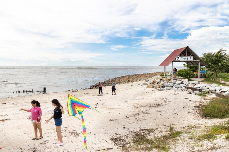 SEKINCHAN, MALAYSIA, February 16, 2020: Sekinchan`s Pantai Redang is popular tourist destination. Relaxng activities including. Kites flying royalty free stock images