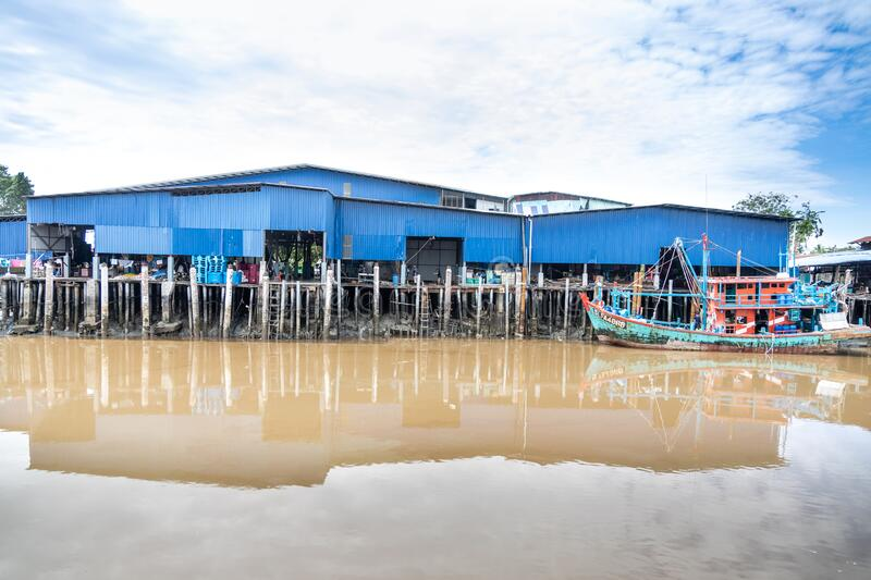 SEKINCHAN, MALAYSIA, February 16, 2020: Sekinchan is source of fresh seafood. Feature here is old fashion fisherman boat docked at. Jetty stock image