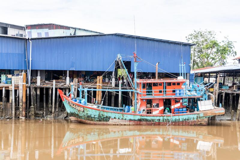 SEKINCHAN, MALAYSIA, February 16, 2020: Sekinchan is source of fresh seafood. Feature here is old fashion fisherman boat docked at. Jetty stock photo