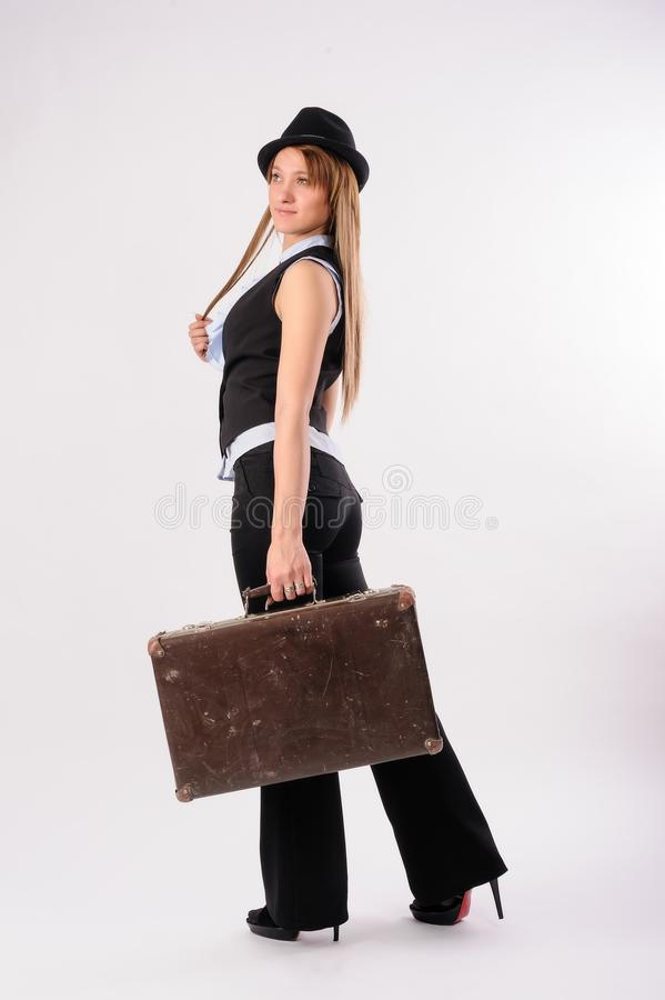 Seksowna blondynki kobieta z rocznik walizką zdjęcia stock