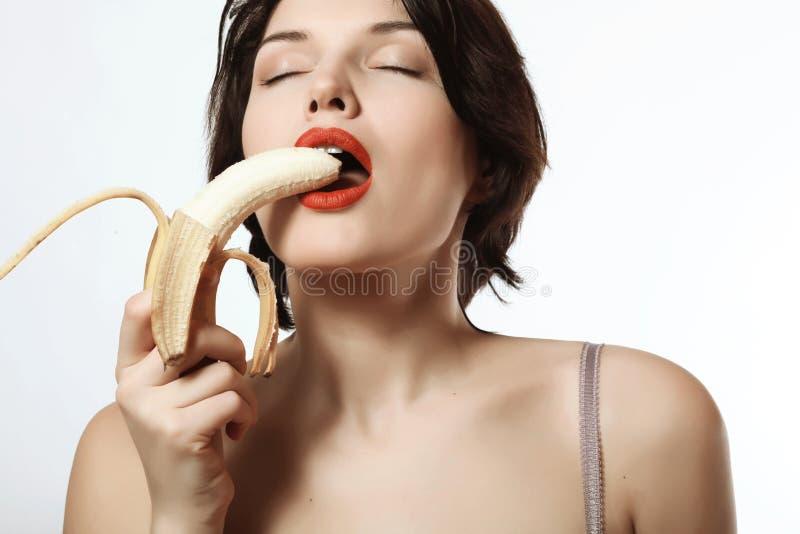 Seksowna dziewczyna z bananem bielizna makeup emocje pasja obraz royalty free