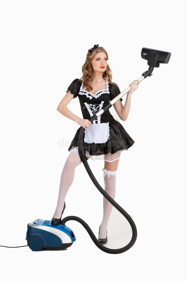 Seksowna gosposia z próżniowym cleaner. fotografia royalty free