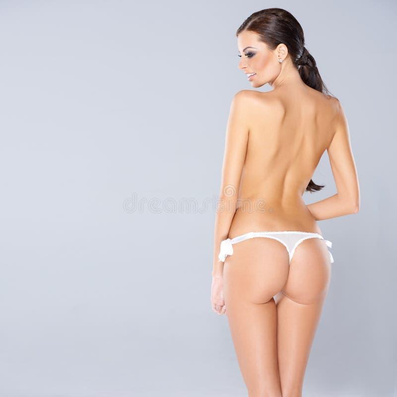 Seksowna kobieta pokazuje daleko jej pośladki fotografia stock