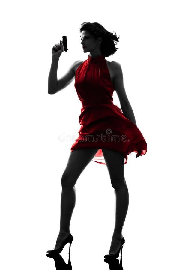 Seksowna kobiety mienia pistoletu sylwetka zdjęcie royalty free