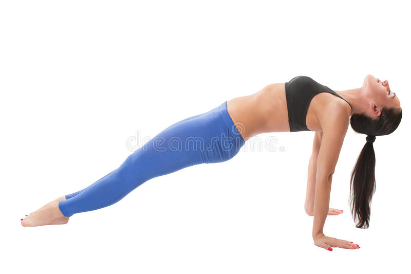 Seksowna młoda joga kobieta robi yogic ćwiczeniu zdjęcia stock