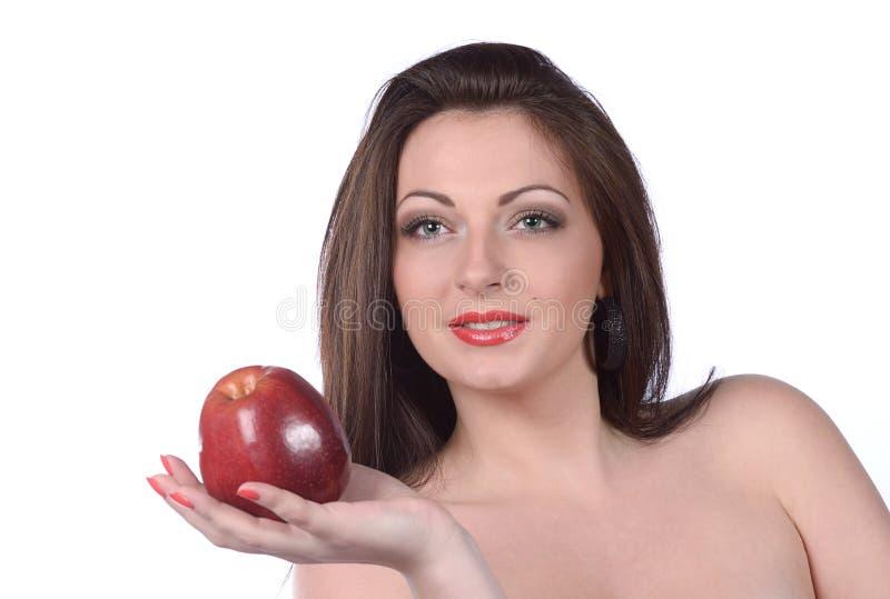 Seksowna młoda kobieta z jabłkiem zdjęcia royalty free