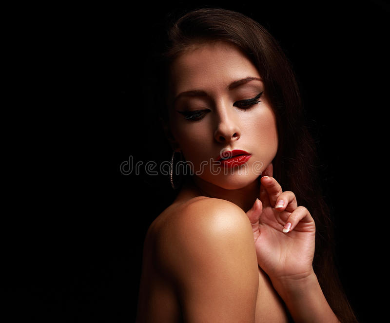Seksowna splendor kobieta patrzeje w dół dotykający twarz obraz royalty free