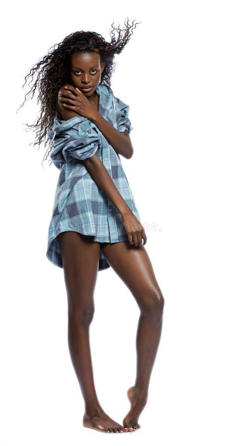 Seksowna tylna kobieta w a obsługuje koszula fotografia royalty free