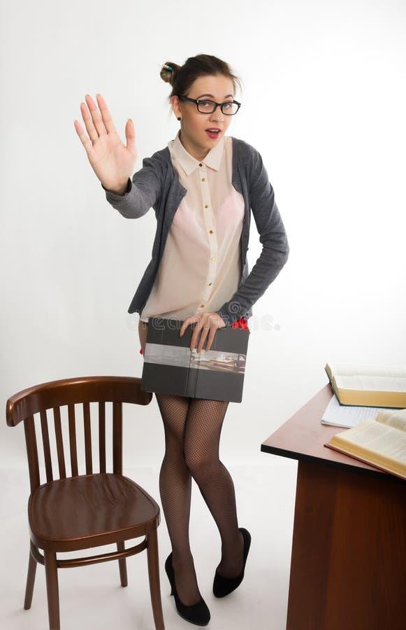 Seksowny młody piękny żeński nauczyciel stoi następnie zdjęcia royalty free