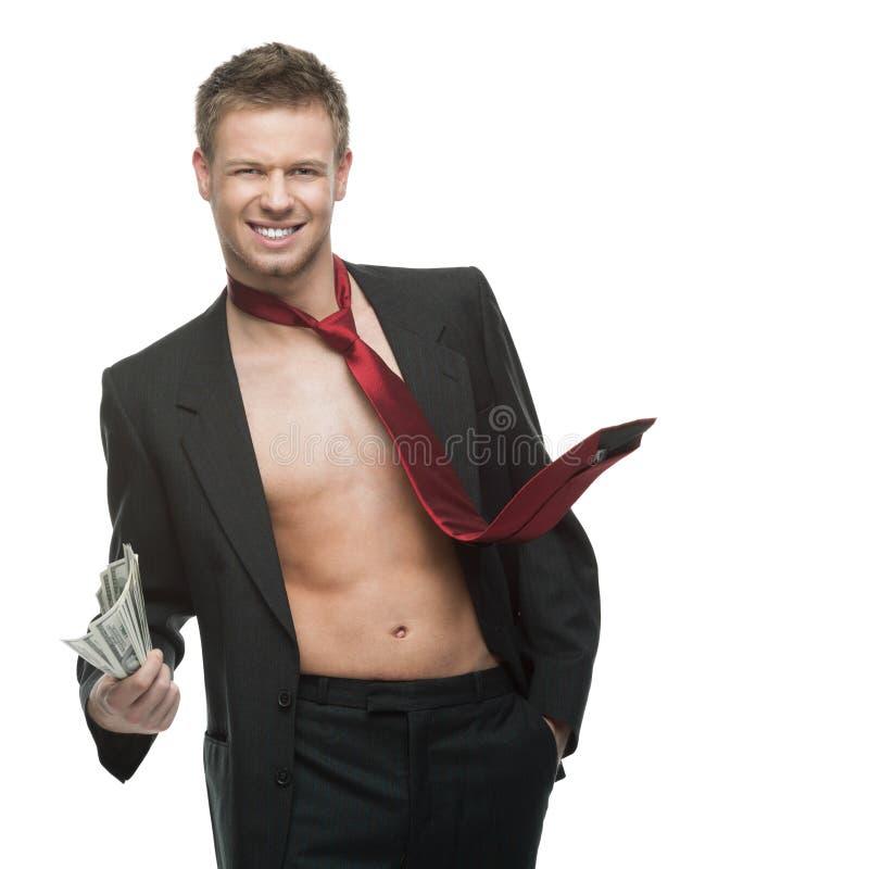 Seksowny target924_0_ biznesmen w czerwonym krawata mienia pieniądze zdjęcia royalty free