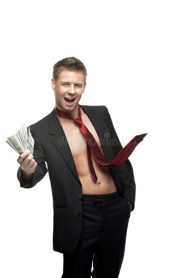 Seksowny target337_0_ biznesmen w czerwonym krawata mienia pieniądze zdjęcie royalty free