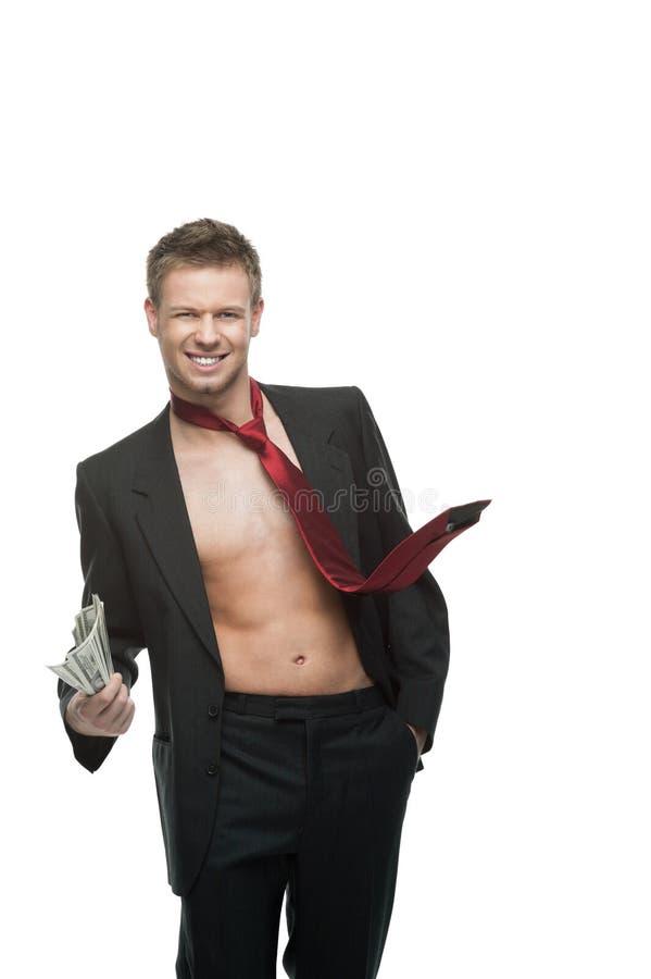 Seksowny target924_0_ biznesmen w czerwonym krawata mienia pieniądze fotografia stock