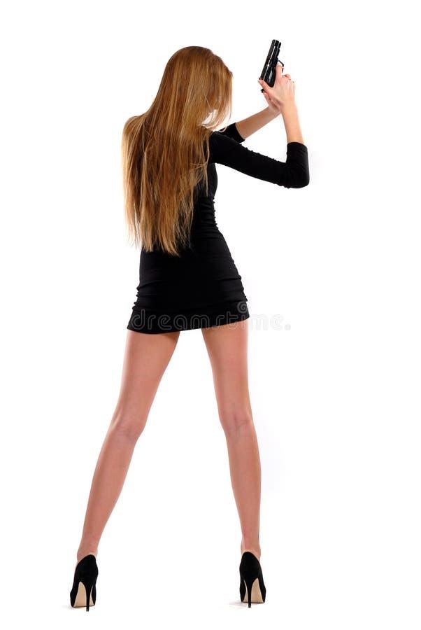 Seksueel meisje met een pistool royalty-vrije stock fotografie