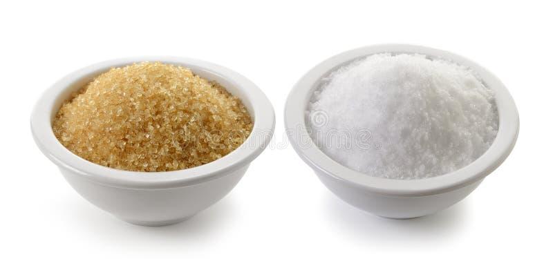 Sel et sucre de mer dans une tasse photos libres de droits
