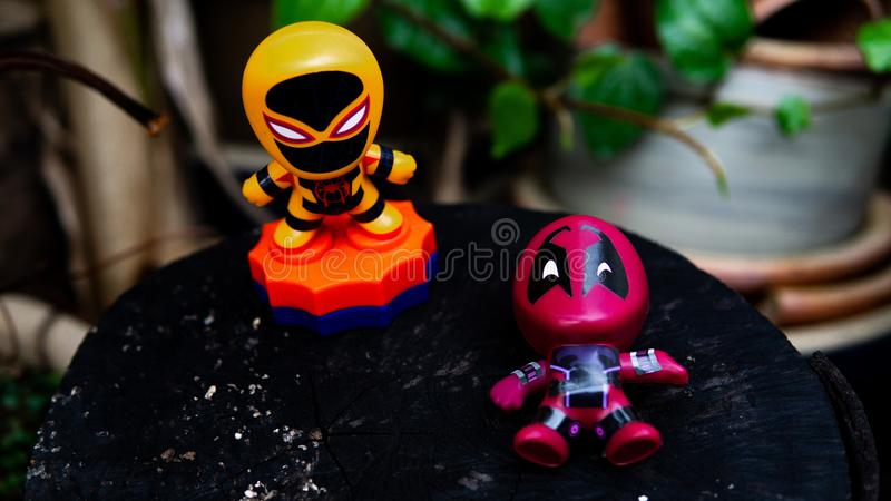 Two McDonald's toy Deadpool lay on the ground and Spiderman stand up. Selangor , Malaysia - March 28, 2019: Two McDonald's toy Deadpool lay on the ground and stock photos
