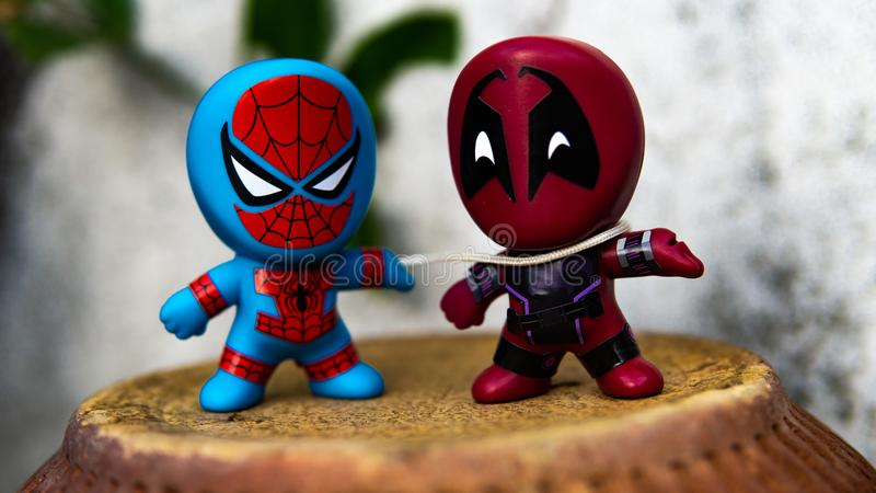 Two McDonald's toy Spiderman use his webs to fight Deadpool. Selangor , Malaysia - March 28, 2019: Two McDonald's toy Spiderman use his webs to fight Deadpool royalty free stock image