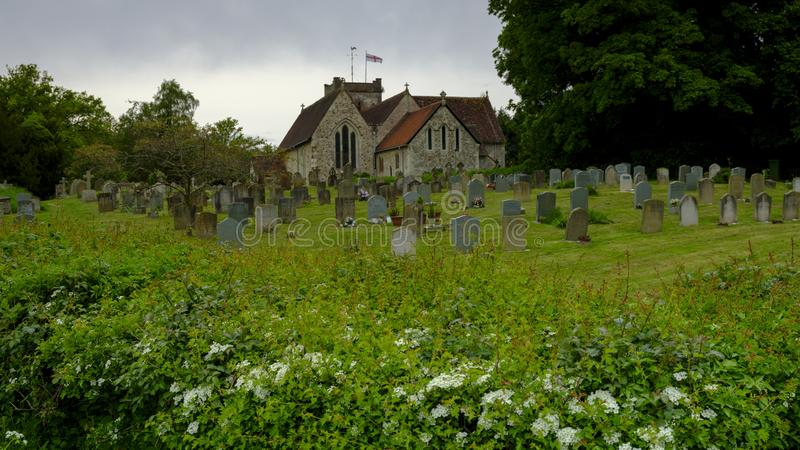 Spring afternoon light on an overcast day - View of St Mary`s Church in Selborne, Hampshire, UK stock photography