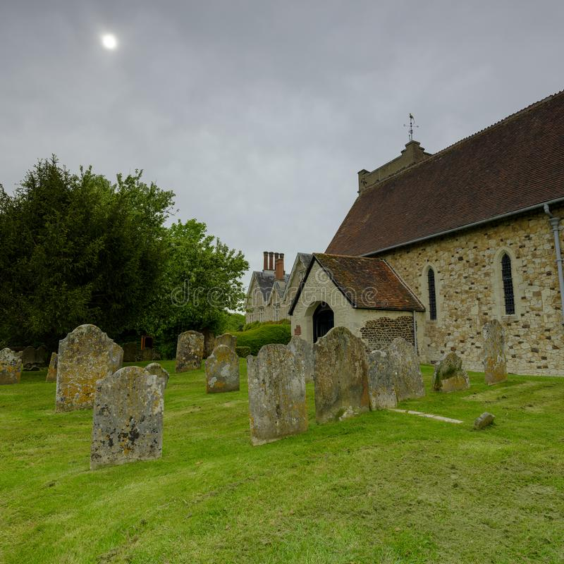 Spring afternoon light on an overcast day - View of St Mary`s Church in Selborne, Hampshire, UK royalty free stock photo