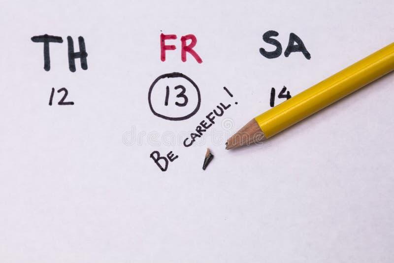 Selbst gemacht Kalender mit Freitag, den 13. und Text auf englisch: ` Ist vorsichtiges ` stockfoto