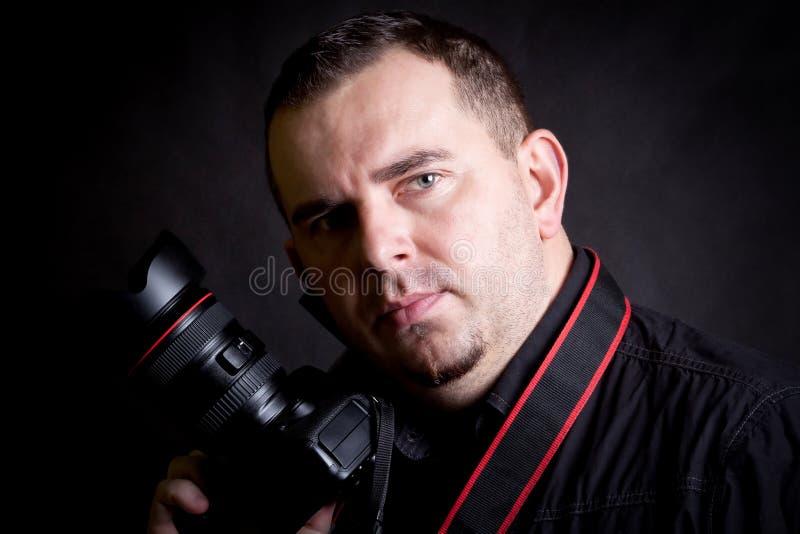 Selbstportrait des Fotografen mit Kamera