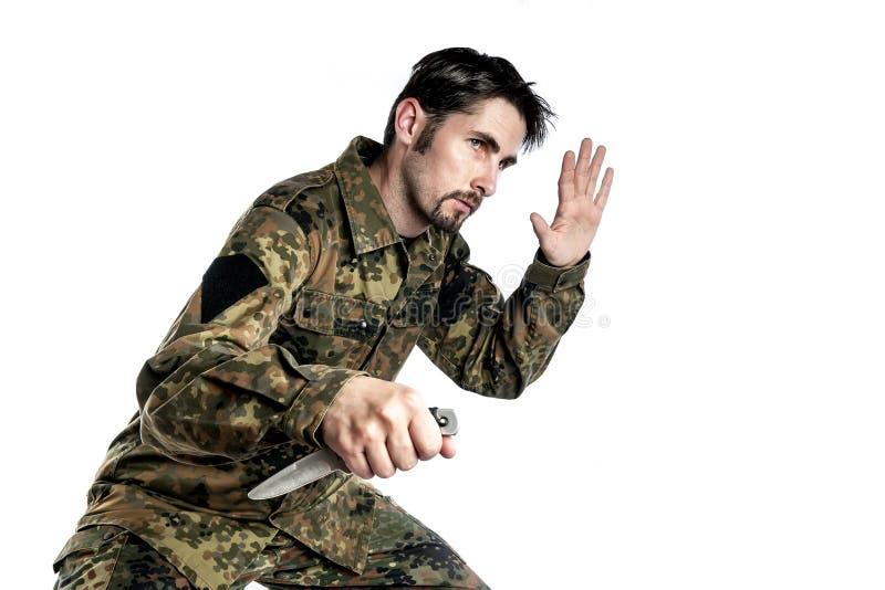 Selbstverteidigungslehrer mit Messer stockbild