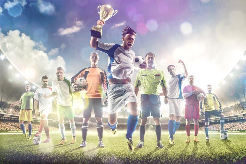 Selebrates för fotbollspelare segern på den storslagna arenan royaltyfri fotografi