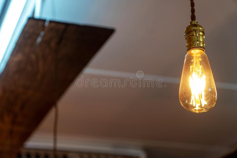 Select focus of vintage lamp decoration in coffee shop royalty free stock photos