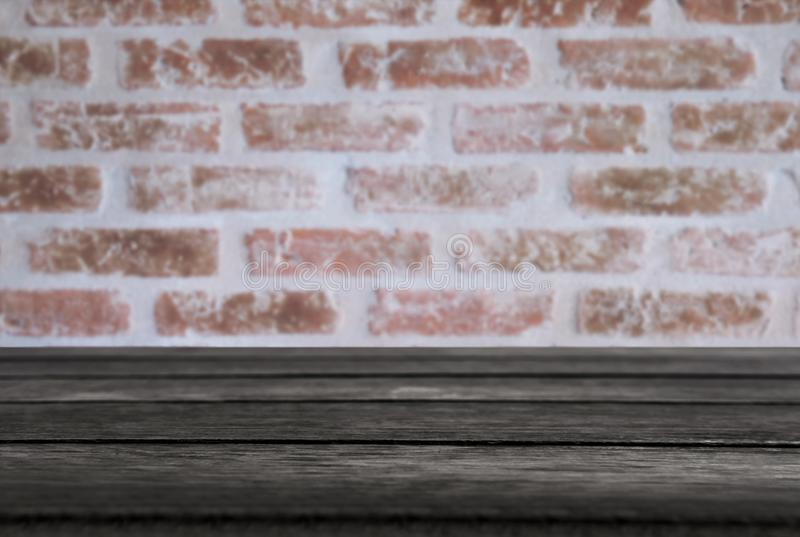 Selected focus empty black wooden table and wall texture or old. Black brick wall blur background image. for your photomontage or product display stock photos