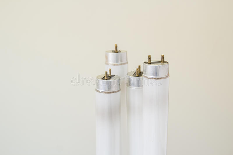 Selected focus garbage fluorescent tube. Selected focus fluorescent light tube.Short depth-of-field stock photography