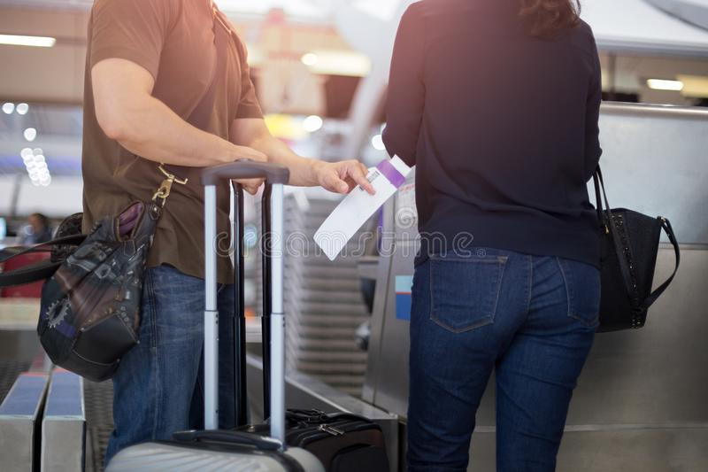 Selected focus on ticket couple standing at airport Check-in desk stock photography
