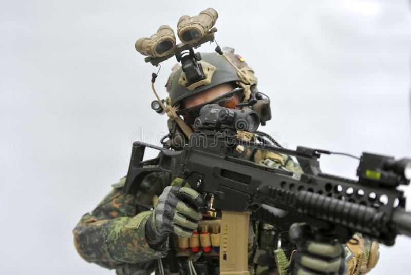 Selected focused of modern army action figure complete with uniform, battle gear and weapon. royalty free stock photos