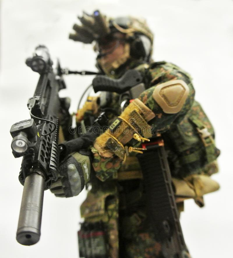 Selected focused of modern army action figure complete with uniform, battle gear and weapon. royalty free stock photo