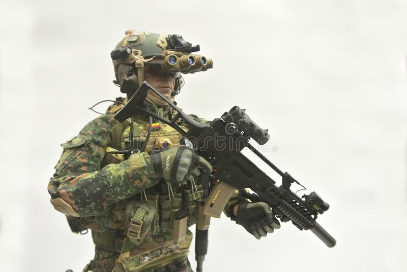Selected focused of modern army action figure complete with uniform, battle gear and weapon. stock image