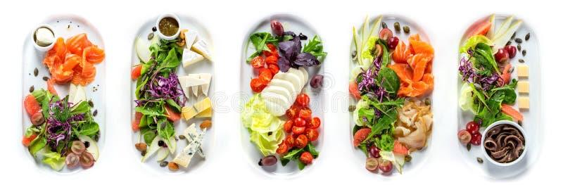Selectie van verschillende soorten kaas en vissen stock foto's
