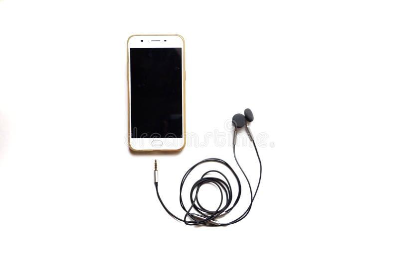 In selectieve nadruk een mobiele telefoon met een hoofdtelefoonkabel royalty-vrije stock afbeeldingen