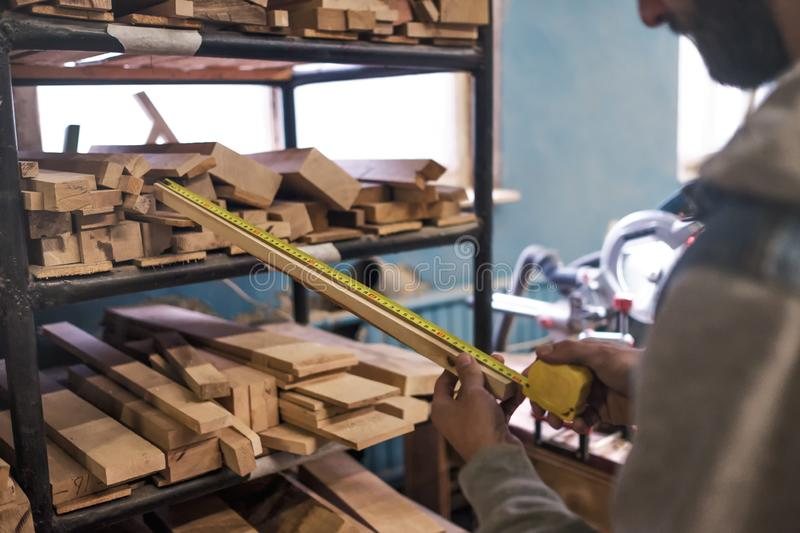 Selecting a board testing its quality for wood work. stock image