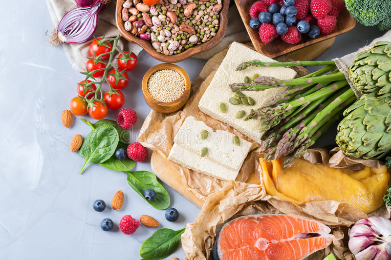 Selection assortment of healthy balanced food for heart, diet. Detox, salmon fish, chicken breast, tofu, seeds nuts broccoli green spinach asparagus, berries stock image