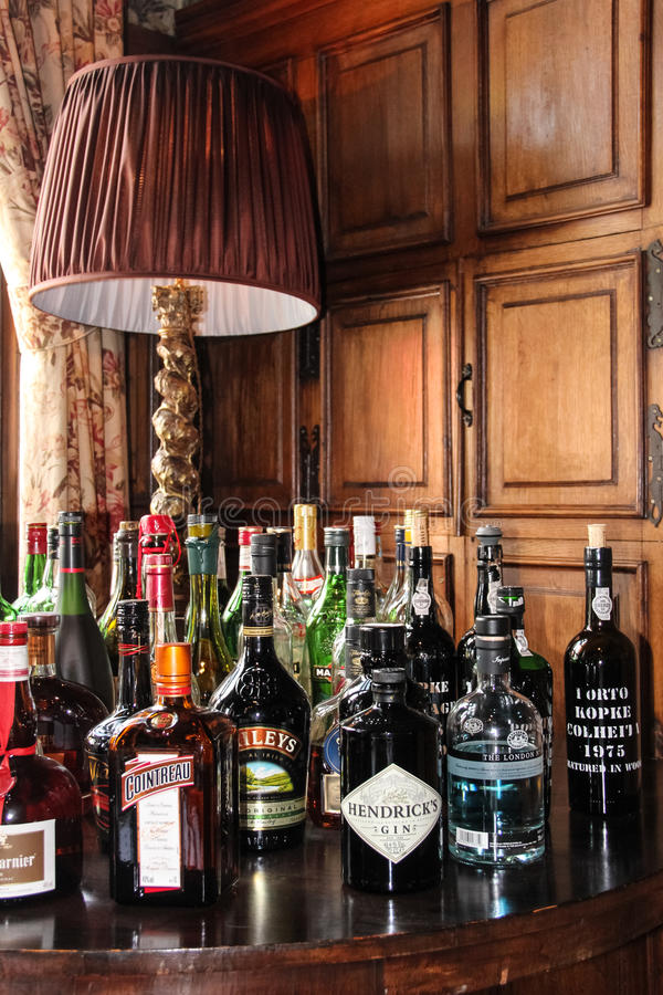 Selection of bottles of alcoholic beverages. A selection of bottles of alcoholic beverages on a table royalty free stock photo