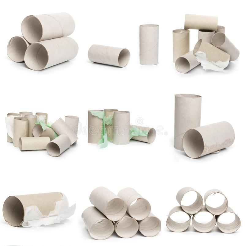 A selection of cardboard toilet paper tubes in various arrangements  on a white background stock photos