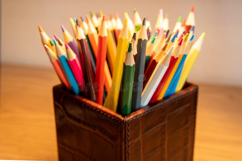 Selection of colored sharpened pencils standing upright in a box stock image