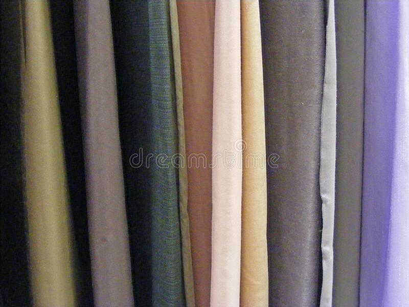 Selection of colorful fabrics for curtains, rolls of fabrics. Woolen, textiles. Colorful fabrics for curtains, rolls of fabrics. Woolen, textiles stock images