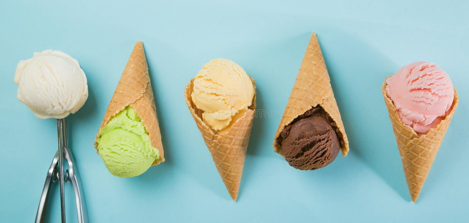 Selection of colorful ice cream scoops on blue background royalty free stock photos