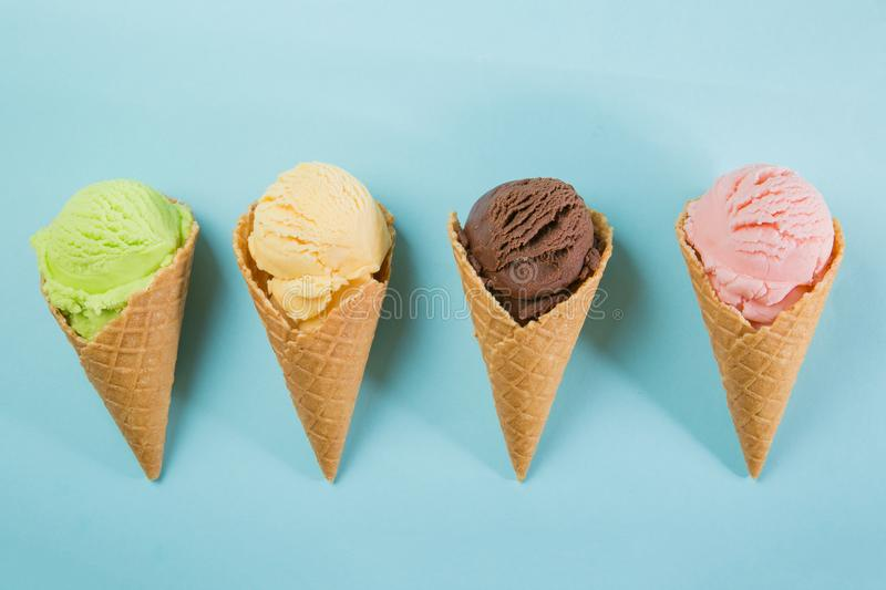 Selection of colorful ice cream scoops on blue background. Top view stock image