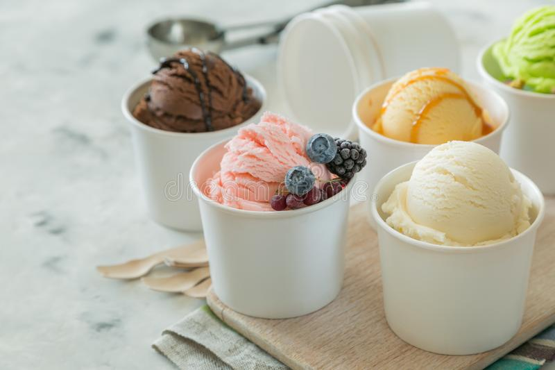 Selection of colorful ice cream scoops in paper cones. Copy space royalty free stock photo
