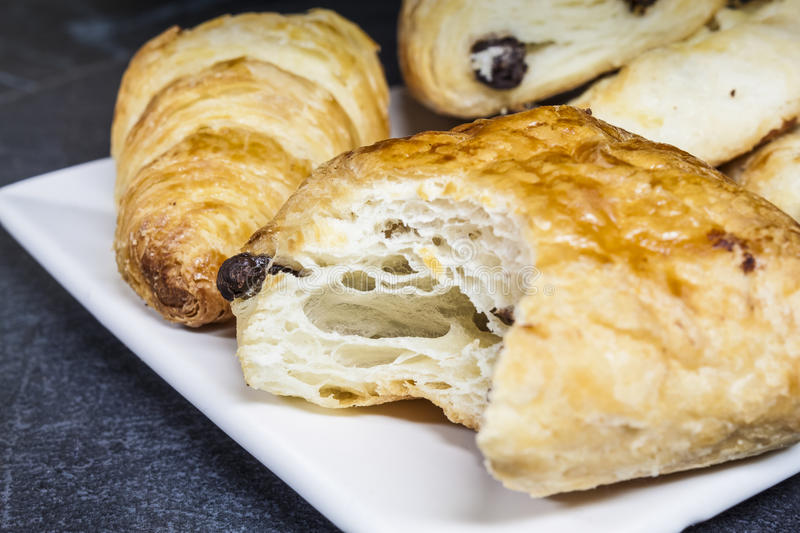 A Selection of Croissants. Croissants and breakfast pastries on a plate with some copy space royalty free stock photos