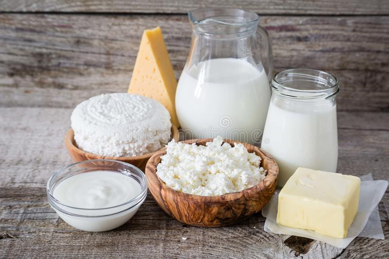 Selection of dairy products on rustic wood bacground. Copy space stock images