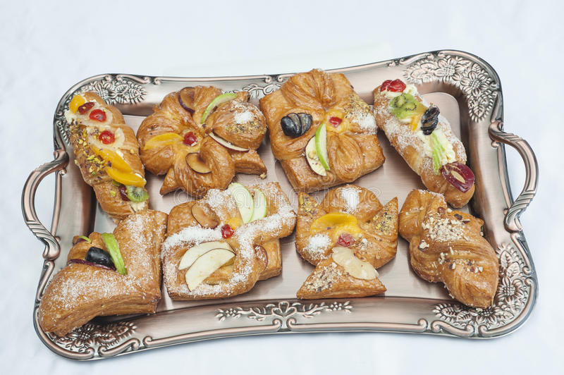 Selection of danish pastries. Selection of luxury danish pastries isolated on a metal plate royalty free stock image
