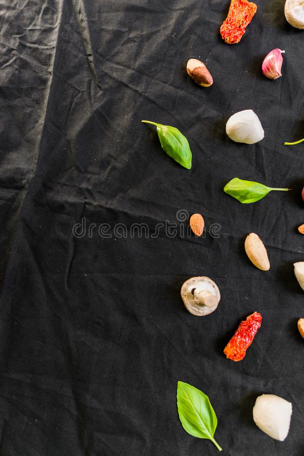 Selection of different Italian food ingredients against black background. Selection of different Italian food ingredients stock images
