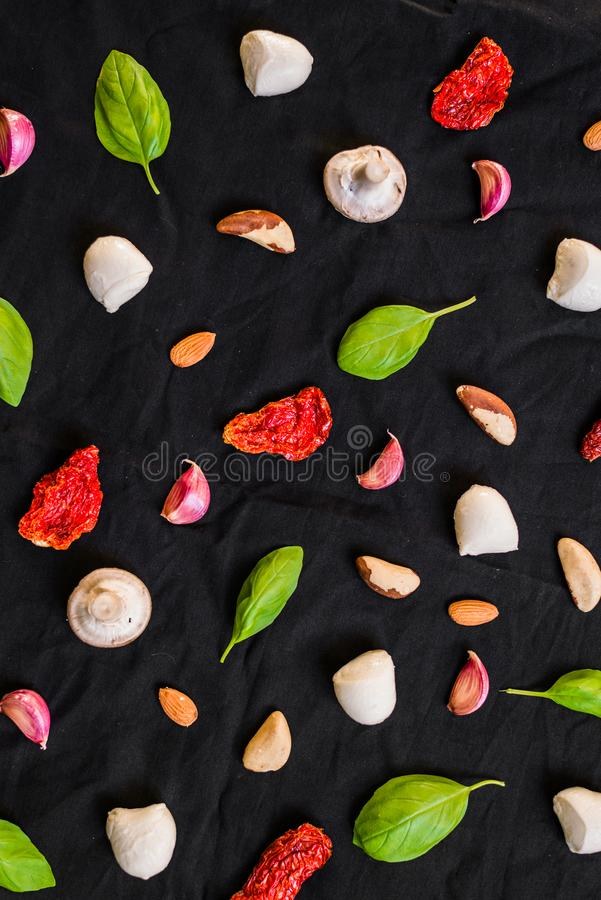 Selection of different Italian food ingredients against black background. Selection of different Italian food ingredients royalty free stock photos